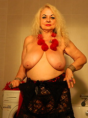 Blonde granny playing in bathroom