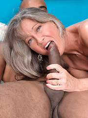 Aged silver babe sucking and riding black cock